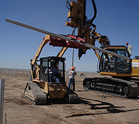 The operator can pick a pole up off the ground or off the back of a trailer